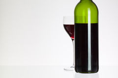 Wine glass and bottle with red wine Royalty Free Stock Images