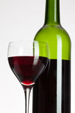 Wine glass and bottle with red wine Stock Photo