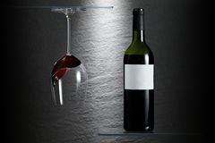 Wine glass and bottle upside down Royalty Free Stock Images
