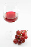 Wine glass and bunch of grapes Stock Photos