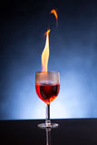 Wine glass with burning alcohol Stock Photography