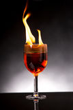 Wine glass with burning alcohol Stock Photos