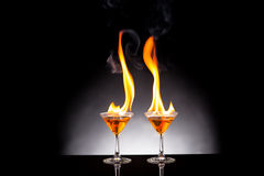 Wine glass with burning alcohol Royalty Free Stock Photos