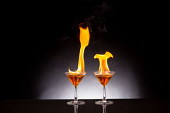 Wine glass with burning alcohol Stock Image