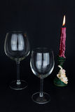 Wine glass and candle on black background Stock Photography