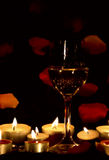 Wine glass and candles Royalty Free Stock Image