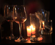 Wine glass with candles Stock Photography