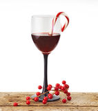 Wine glass with candy cane Royalty Free Stock Photography