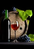 Wine glass, cask and grapes Royalty Free Stock Photography
