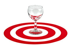 Wine glass in the center of red target Royalty Free Stock Photography
