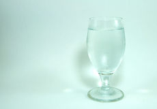 Wine glass and champagne cork on white background. Wine glass and champagne cork put on white background stock images