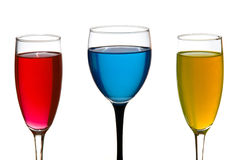 Wine glass and champagne glasses. Colorful liquid Stock Images