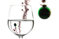 Wine glass and christMAS DECORATION. Wine glasses in backlight on white contrast background with christmas decoration Stock Images