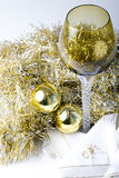 Wine glass on a Christmas New Year decorated table. Luxurious expensive tall wine glass on a beautiful Christmas New Year theme decorated table with golden color Stock Photos