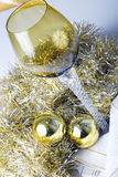 Wine glass on a Christmas New Year decorated table. Luxurious expensive tall wine glass on a beautiful Christmas New Year theme decorated table with golden Stock Images