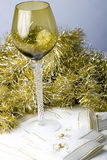 Wine glass Christmas New Year table decoration. Luxurious expensive tall wine glass on a beautiful Christmas New Year theme decorated table Royalty Free Stock Photos