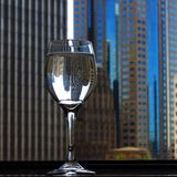 Wine Glass with City in Background Royalty Free Stock Photos