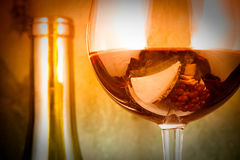 Wine glass close up. With a bottle Royalty Free Stock Images