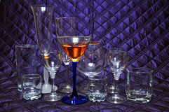 Wine glass collection. Glass on the purple background Royalty Free Stock Photography