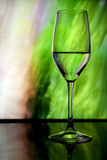 Wine glass with colorful background stock image