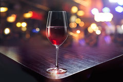 Wine glass on colorful bar background Royalty Free Stock Photography