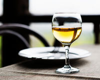 Wine glass and cutlery on the table. Stock Photo