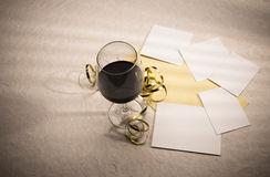 Wine glass and decorations with blank photo shapes Stock Photography