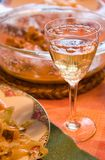 Wine glass with dinner. Closeup of wine glass with dinner on the table Royalty Free Stock Photos