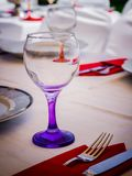 Wine glass in a dinner table stock photos