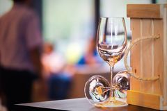 Wine glass empty on the table near box royalty free stock photo