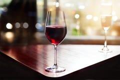 Wine glass in entertaining room among sunset window Stock Image