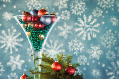 Wine glass filled with christmas tree balls Royalty Free Stock Photos