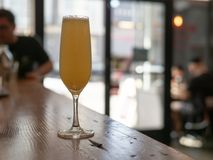 A wine glass filled with a mimosa at a restaurant royalty free stock images