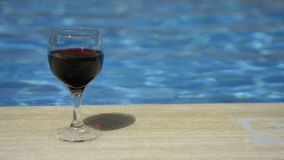 Wine glass filled with wine. stock footage