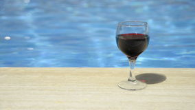 Wine glass filled with wine. stock video footage