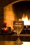 Wine glass by fire in home Royalty Free Stock Photos
