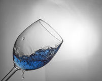 Wine glass fluid motion Stock Images