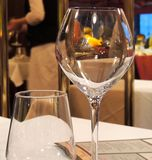 Wine glass in french restaurant Stock Image