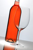 Wine glass in front of bottle Stock Photo