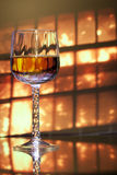 Wine glass in front of window stock photography