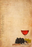 Wine in glass and fruit on old paper background Stock Photos