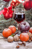 Wine glass with fruits and nuts Stock Photography