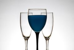 Wine glass full of blue liquid Royalty Free Stock Photography