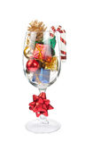 Wine glass full of Christmas decorations Stock Photos