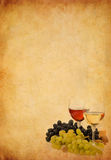 Wine in glass and grape on old paper background. Wine in glass and grape fruit on old paper parchment background royalty free stock photos