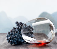 Wine glass with grape on wooden table Royalty Free Stock Photos