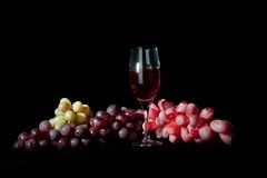 Wine glass with grapes Stock Photography