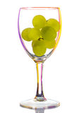 Wine glass with grapes Stock Images