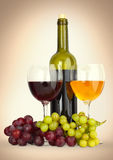 Wine in glass with grapes Royalty Free Stock Images