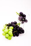 Wine glass with grapes Royalty Free Stock Photos